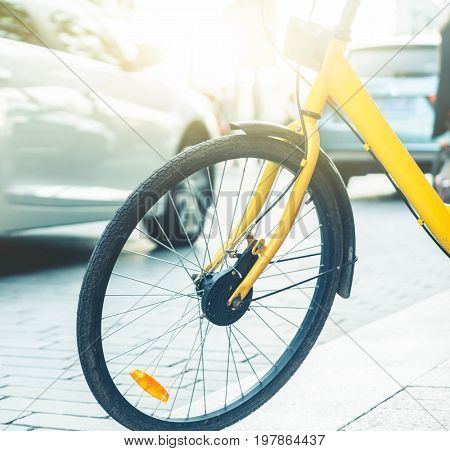 closeup of a shared bicycle parked on sidewalk