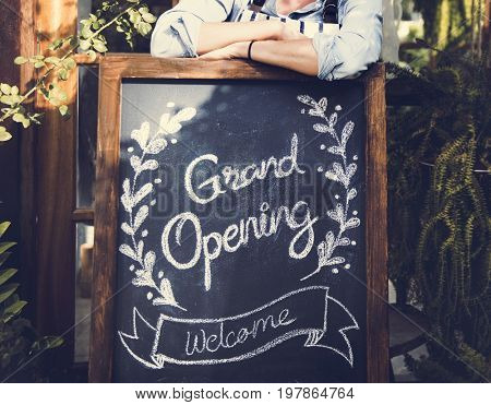 Adult Man Standing with Grand Opening Sign