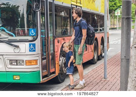 Father And Son Going To Go By Bus In Hong Kong