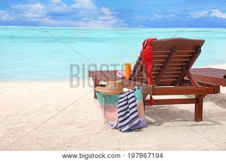 Beach accessories and sun lounger at sea resort
