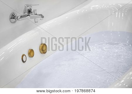 New jacuzzi bathtub filled with water in store