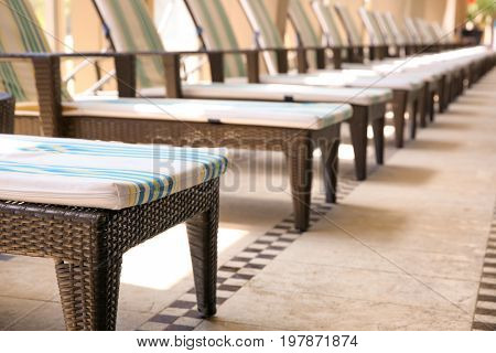 Comfortable chaise longues at resort