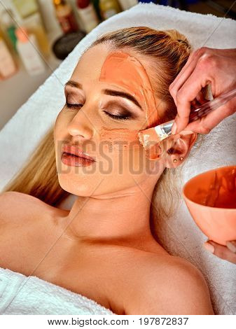 Collagen face mask. Facial skin treatment. Face of woman receiving cosmetic procedure in beauty salon close up number one isolated. Mask against sagging skin.