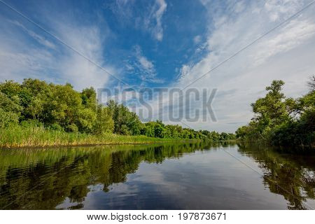 Landscape with nice clouds in sky over river