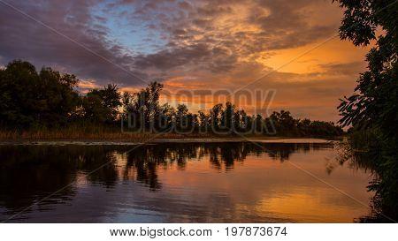 nice summer sunset scene over river
