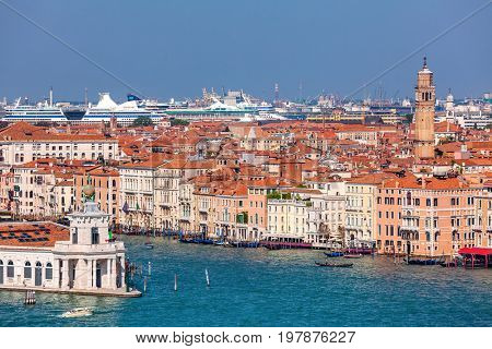 View of Grand canal and old houses with red roofs in Venice, Italy.