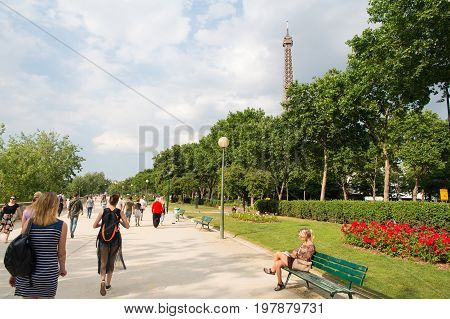 Paris France-June 1. 2017 :Eiffel Tower at sunset in Paris France. Romantic travel background. Eiffel tower is traditional symbol of paris and love.