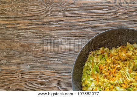 Sliced Vegetables Stew In A Pan On Old Wooden Table.