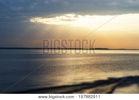 Sunset rays over the ocean with boat trace background hd