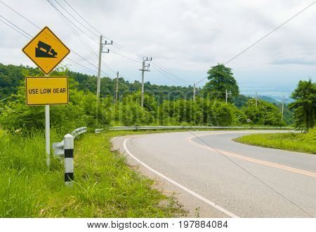 Road sign beware slope be careful of the steep