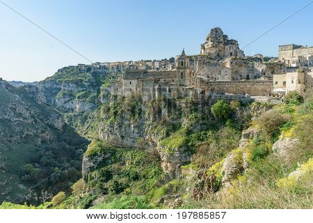 ancient ghost town of Matera (Sassi di Matera) in beautiful sun shine with blue sky southern Italy.