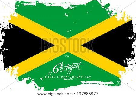 Jamaica Happy Independence Day, 6 august greeting card with jamaican flag brush stroke background and hand lettering. Vector illustration.