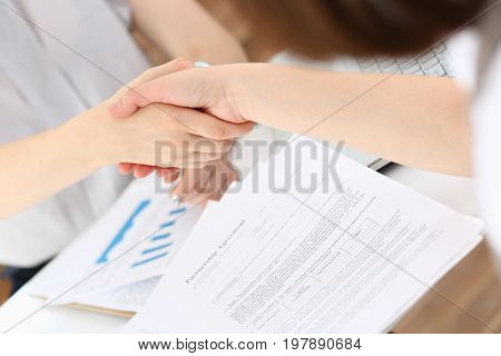 Businesswoman And Woman Shake Hands As Hello In Office