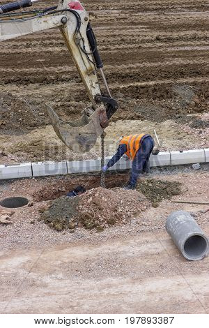 Road Workers Installing Storm Drain System 2