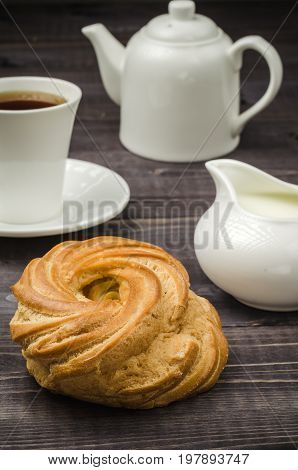 pastries creamer cup of coffee and teapot