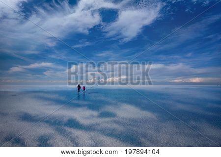 Uyuni, Bolivia- March 25, 2017:People walking on the lake Salar de Uyuni Bolivia