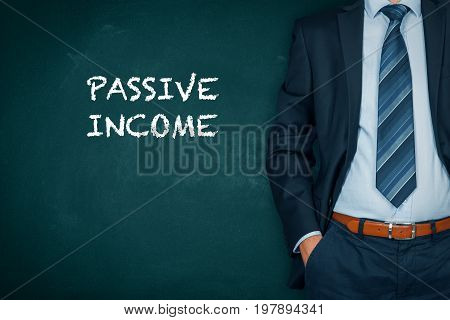 Passive income concept. Businessman with hands in passive gesture and increasing graph with text passive income.