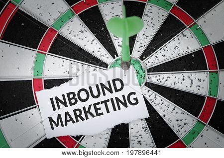 Inbound marketing on notepaper with dart arrow and dart board. Business concept.