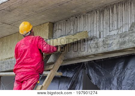 Man Installing External Wall Insulation 2
