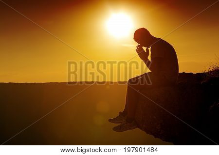 Young man sunset pray person one adult