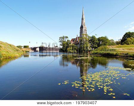 Reflections of St. Alban's Church on the Pond of the Kastellet (Citadel) in Copenhagen, Denmark