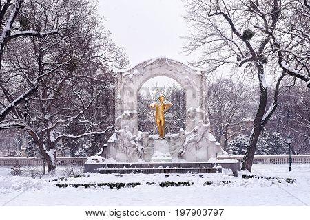 Golden monument of Johann Strauss in city park of Vienna Austria
