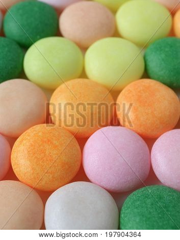 Close-up of Beautiful Colored Round Candies, Selective Focus for Background and Texture