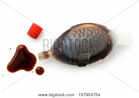 Open Fish Shaped Take Away Soya Sauce Isolated On White From Above. Spilled Sauce.