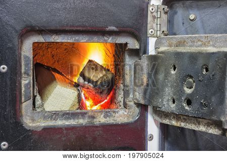 Wood Stove Firebox With Fire And Wood 2