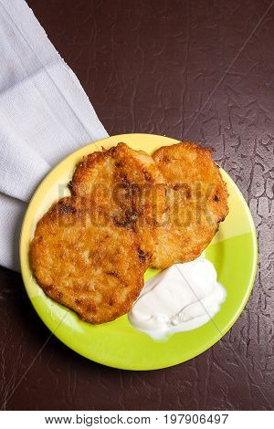 Potato Pancakes With Meat And Sour Cream On Green Plate In Belarusian Style On Dark Background.