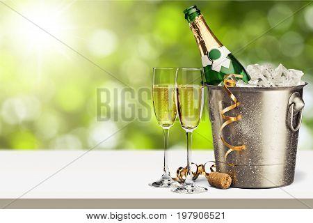 Bottle champagne glasses bar color background holiday