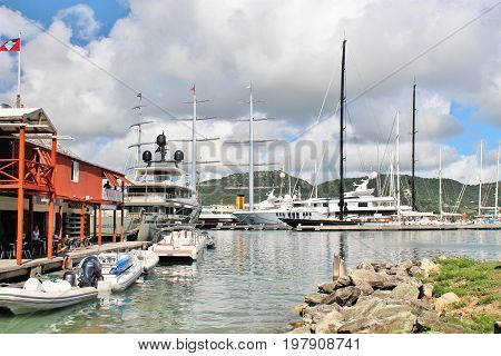 Boats and yahts docked - December 4 2016 - boast and yachts docked at a Marina on the island of Antigua