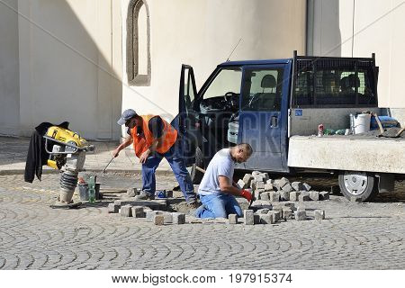 Opava Czech Republic 31 March 2017 Editorial Photo of stonemason who is repairing cobblestone road. Opava Czech Republic