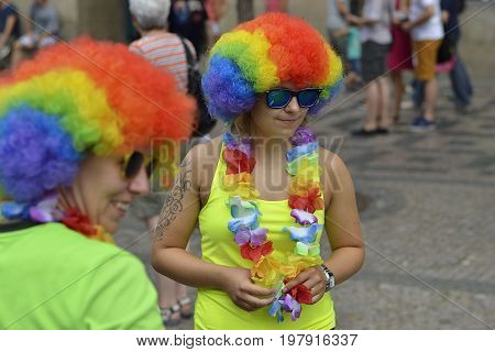 Prague, Czech Republic, 15 August, 2015, Editorial photo of two girls who is wearing fancy festival dress with rainbow wig, Prague, Czech Republic, St. Wenceslaus square
