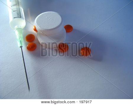 Tablets & Syringe
