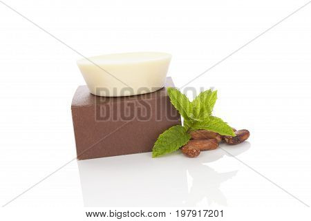 Natural healthy mint cocoa massage soap with cocoa seeds isolated on white background. Natural cosmetics.