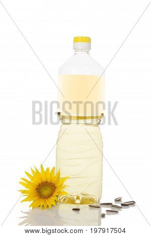 Sunflower oil in bottle with blank label and sunflower seeds isolated on white background.