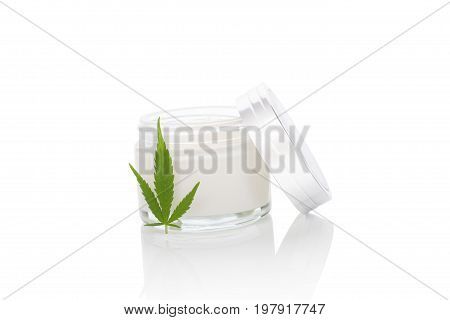Moisturizing Hemp Hand Cream in dose with Cannabis leaf isolated on white background. Cannabis cosmetics.