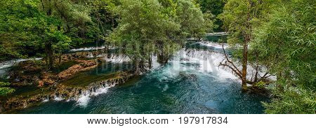 Una River. Waterfall in Martin brod. Bosna and Hercegovina. Beautiful big waterfall on the wild river.