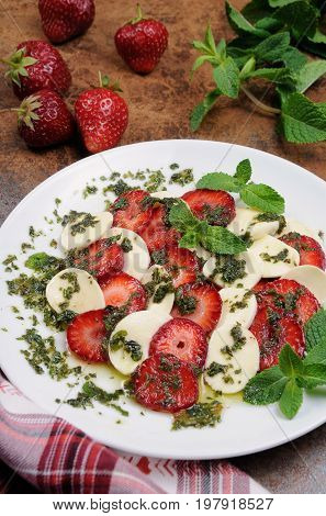 Light snack caprese with strawberries and mozzarella dressed mint pesto