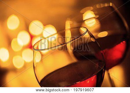 Red wine glasses bar color background festive