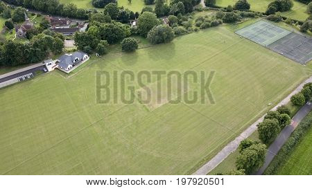 Aerial photo rural English village Cricket pitch and pavilion