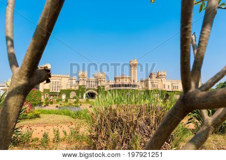Main Buildings Of Bangalore Palace, With Blurred Tree Branches In The Foreground, Bangalore, Karnata