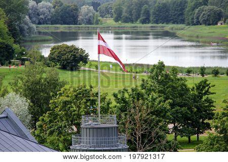 Latvian flag and lake, city Talsi, Latvia
