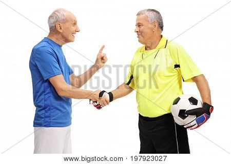 Soccer player and a goalkeeper shaking hands isolated on white background