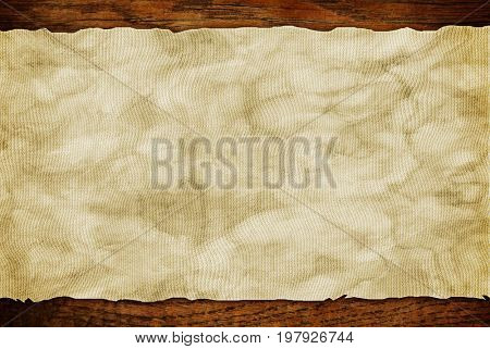 Grunge paper sheet on wooden wall or table in loft style