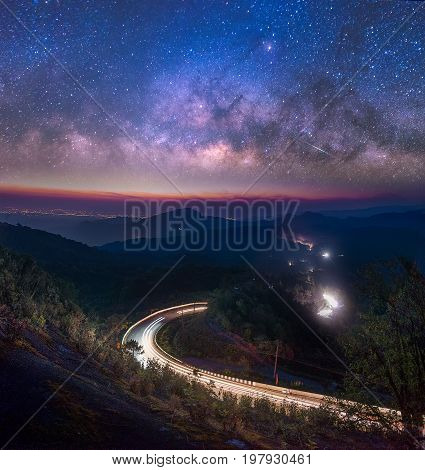 Milky Way Galaxy with street and light trails on Doi inthanon Chiang mai, Thailand.