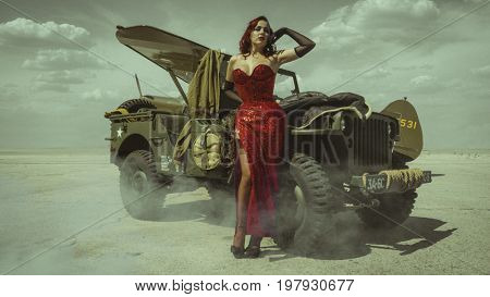 Uniform, Beautiful redhead girl dressed in style pinup of the second world war, next to a military truck