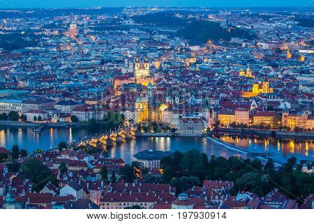 Prague at twilight blue hour view of Charles Bridge on Vltava with Mala Strana and Old Town.