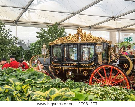 LONDON UK - MAY 25 2017: RHS Chelsea Flower Show 2017. Visitors observing the Australian State Coach and the Bowdens hostas in the Great Pavilion.